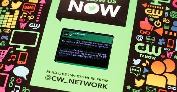 Interactive print ad by CW Network with LCD screen in issue of Entertainment Weekly.